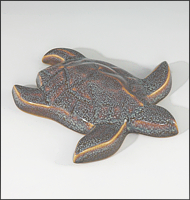 Image of Baby Sea Turtle sculpture in starfield blue glaze, seen  from above, facing to the viewers right.